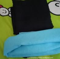Hijab hitam dan biru
